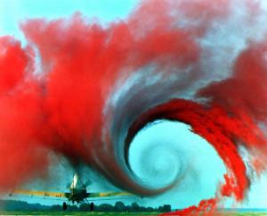 Tourbillon créé par le passage d'un avion, il est ici révélé par de la fumée rouge.